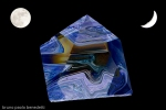 on black background with one full and one half moon hyaline quartz pyramid with blue and brown shades