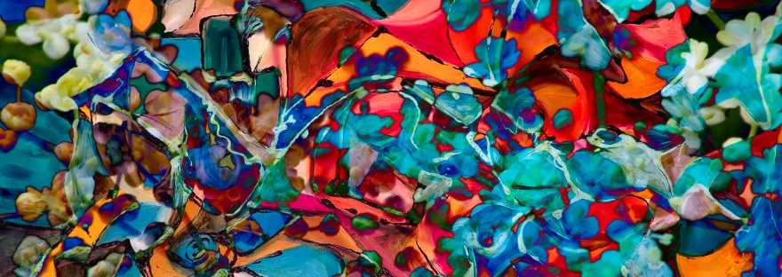 abstract dappled art composition with mulltiform colored shapes in dominant red and blue tones